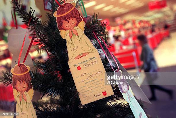 MEangeltree11126AS––SANTA ANA––The Salvation Army Christmas Tree at Target in Santa Ana where the public is encouraged to select an angel with a...