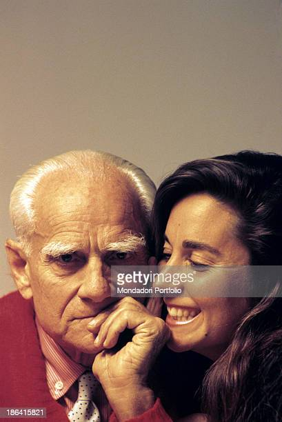 Meaningful closeup of the Roman writer and journalist Alberto Moravia with his third wife the writer Carmen Llera whom he married in 1986 at the...