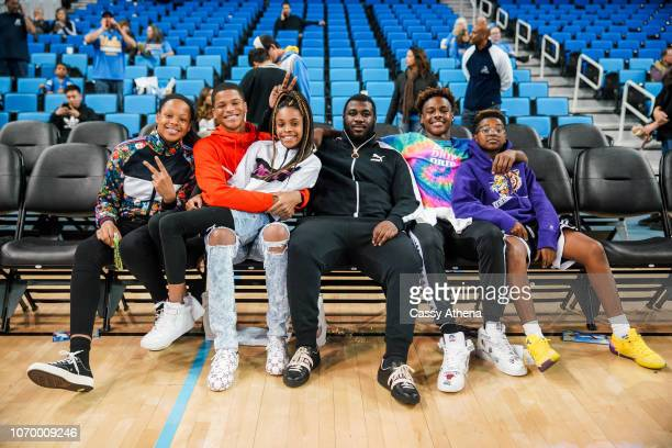 Me'Arah O'Neal Shaqir O'Neal Gregory Jordan LeBron James Jr and Bryce James sit court side after a game against the UCLA Bruins and the Presbyterian...