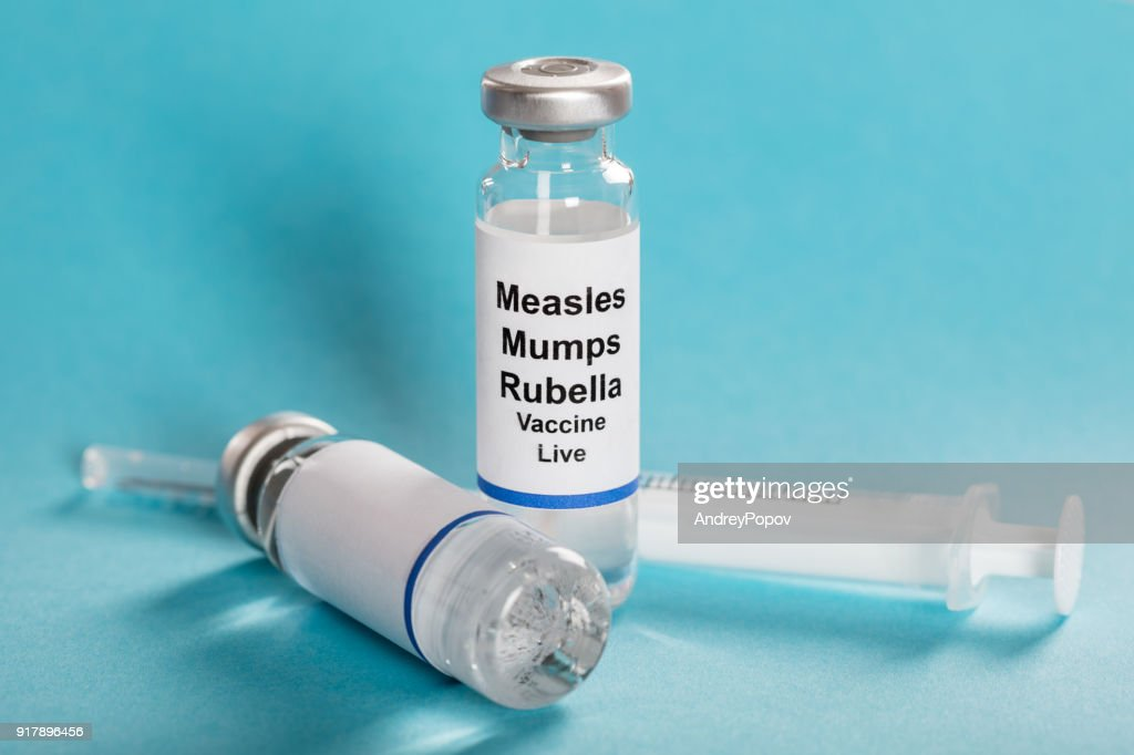Measles Mumps Rubella Vaccine Vials With Syringe : Stock Photo