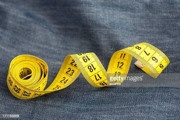 Measure tape on jeans