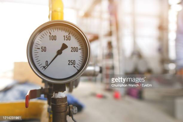 measurement equipment installed on stainless steel pipes in industrial systems - celsius stock pictures, royalty-free photos & images