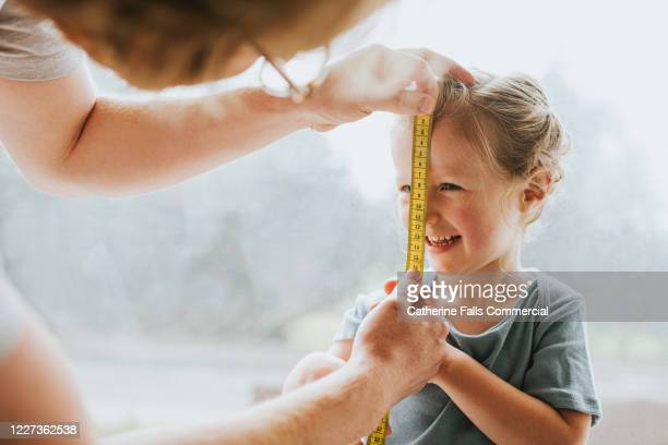 measuring a child's face - carefree stock pictures, royalty-free photos & images