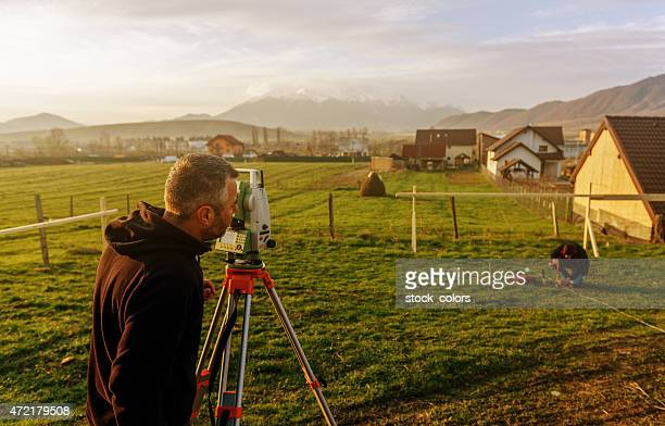 measuring and working on construction site - surveyor stock photos and pictures
