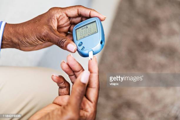 measuring blood sugar - diabetes stock pictures, royalty-free photos & images