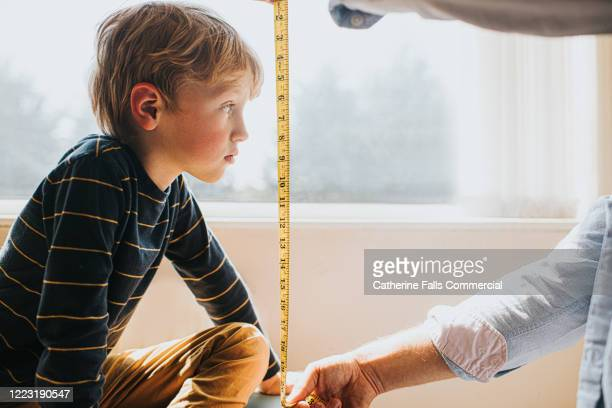 measuring child - instrument of measurement stock pictures, royalty-free photos & images