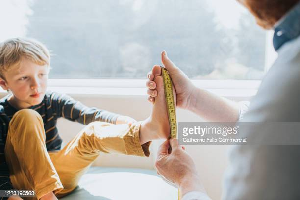 measuring child's foot - length stock pictures, royalty-free photos & images