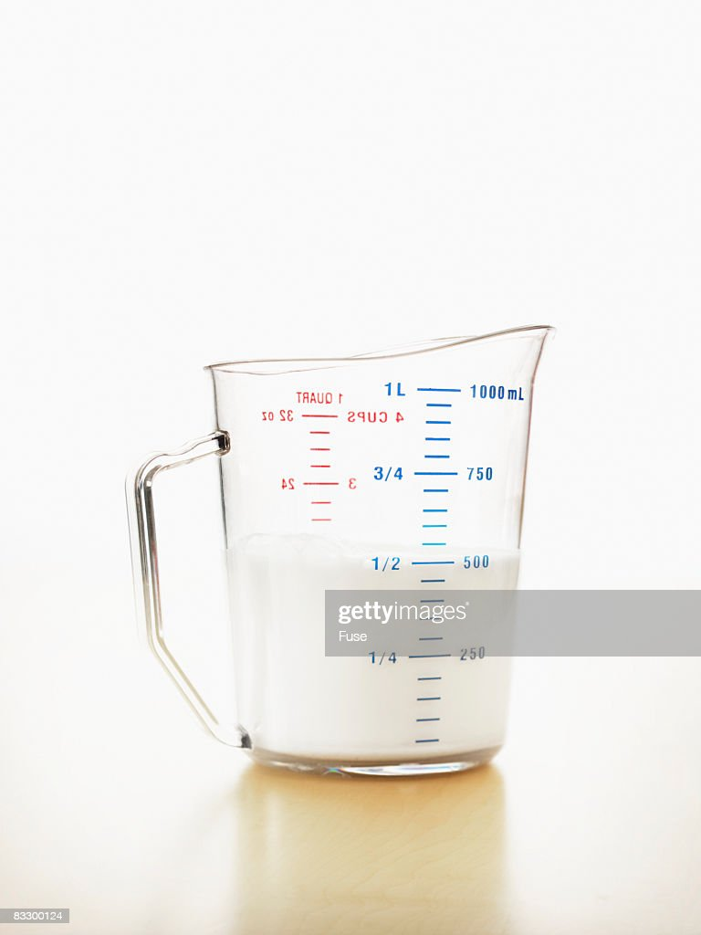 Measuring Cup of Milk : Stock Photo