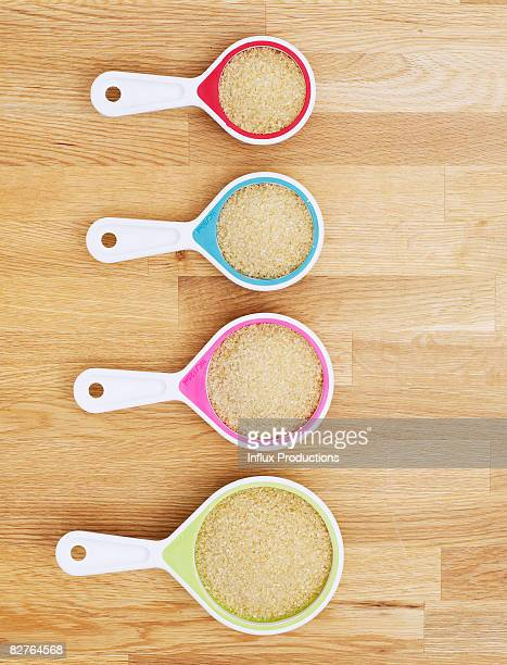 Measuring cups full of sugar