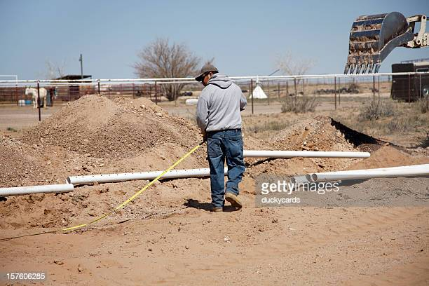measuring for installation of septic tank and drain field - septic tank stock photos and pictures