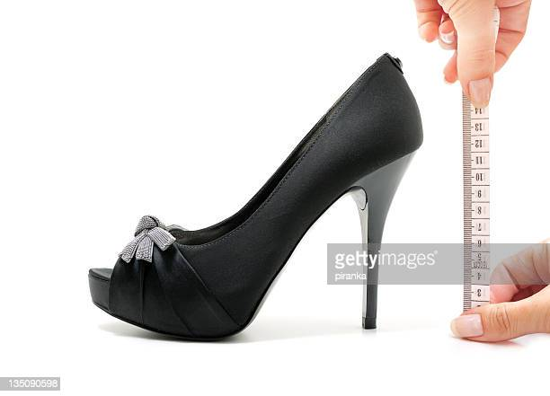 measuring high heels - centimetre stock photos and pictures