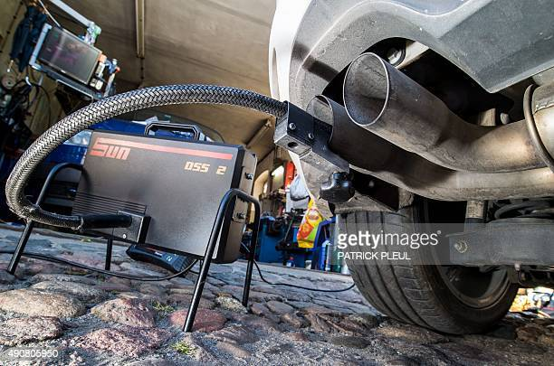 A measuring hose for emissions inspections in diesel engines sticks in the exhaust tube of a Volkswagen Golf 20 TDI diesel car at a garage in...