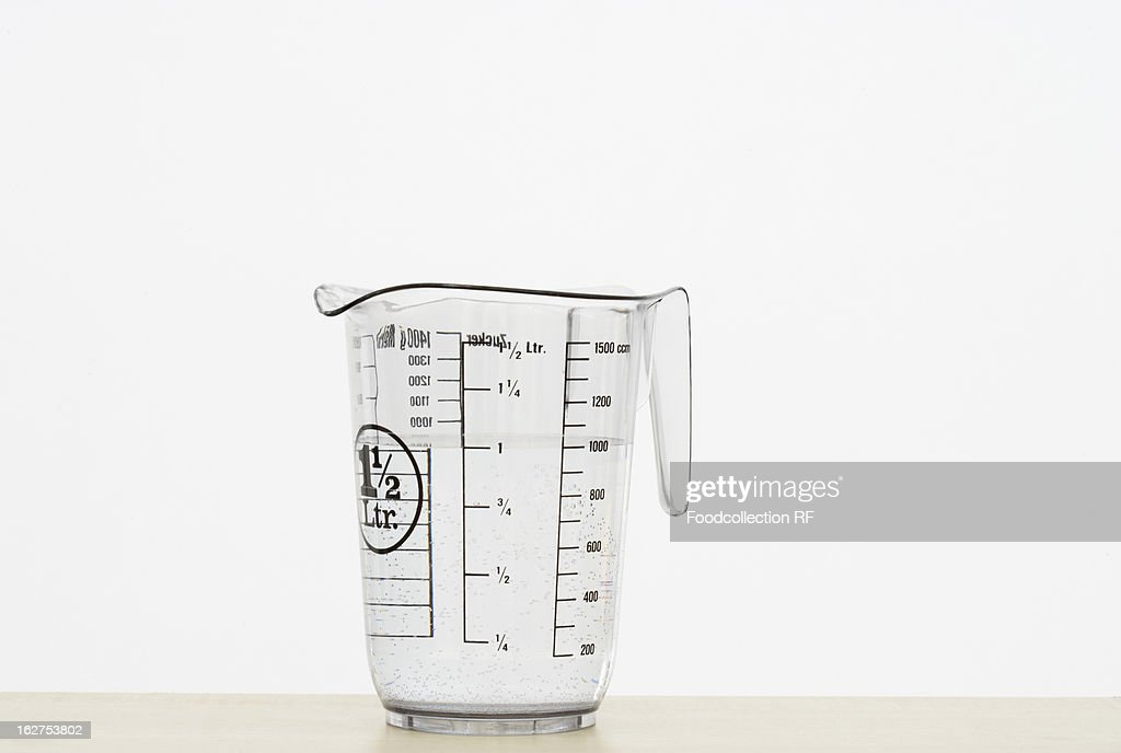 Measuring jug on white background : Stock Photo