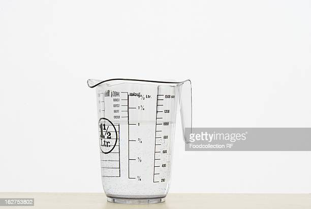 Measuring jug on white background