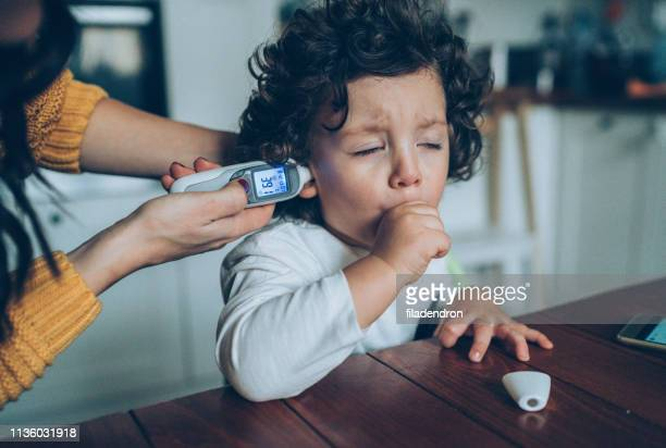 measuring little boy's temperature - cough stock pictures, royalty-free photos & images