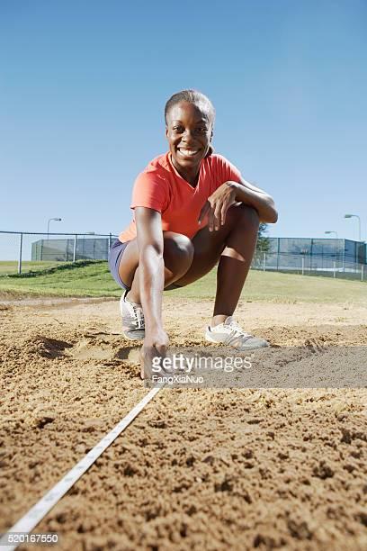 measuring long jump - 中距離 ストックフォトと画像