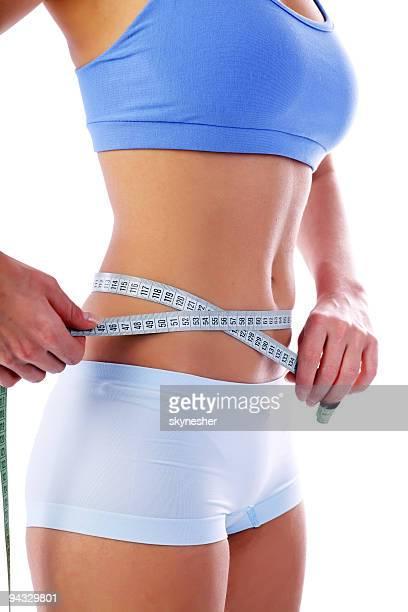 slim linda fita métrica ao redor da cintura. - medindo - fotografias e filmes do acervo