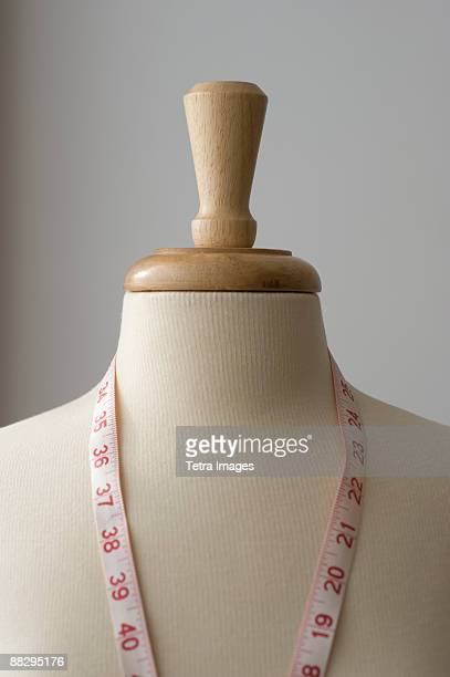 Measuring tape on dressmakers model