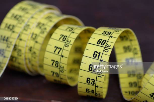 measuring tape on wooden table - centimetre stock photos and pictures