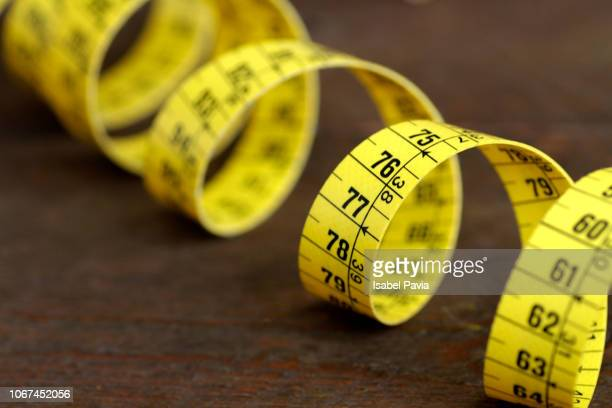 measuring tape - centimetre stock photos and pictures