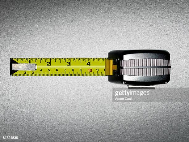 A measuring tape with five inches showing