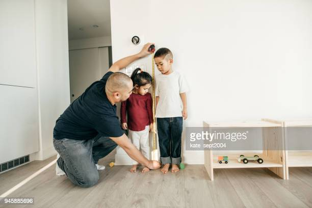 measuring the height of the children - measuring stock pictures, royalty-free photos & images