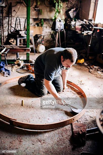 Measuring the metal tyre, for a wooden cartwheel, skilled Wheelwright