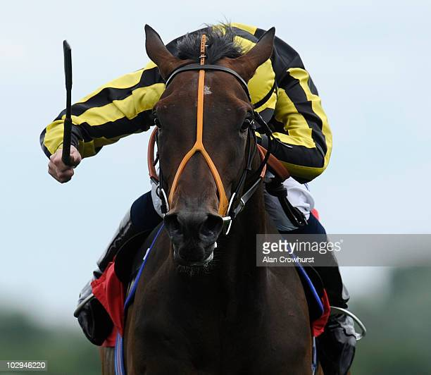 Measuring Time and Ryan Moore win The Harold Pack Memorial Conditions Stakes at Newbury racecourse on July 17 2010 in Newbury England