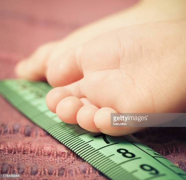 Measuring tiny baby foot with a meter