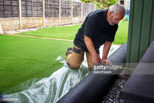 measuring up - turf stock pictures, royalty-free photos & images