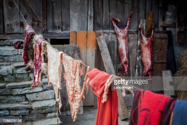 Meat and clothes drying out on a washing line in Lete in Nepal.