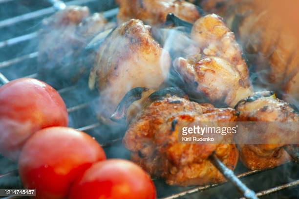 meat and vegetables on a grill - close to stock pictures, royalty-free photos & images