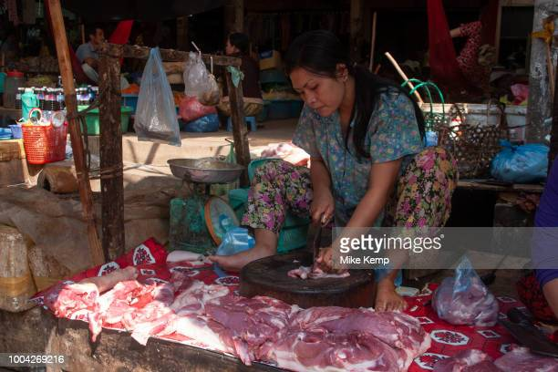 Meat area of Psar Leu market Angkor Cambodia Here the meat hangs in the air and sits on the floor as the sellers raised up cut and sell the meat at...