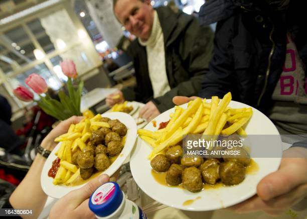 Meat balls are served in a restaurant of Ikea in Amsterdam on March 23 2013 Swedish furniture giant Ikea said last week it had started gradually...