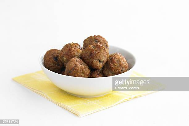 Meat balls in a white bowl, studio shot
