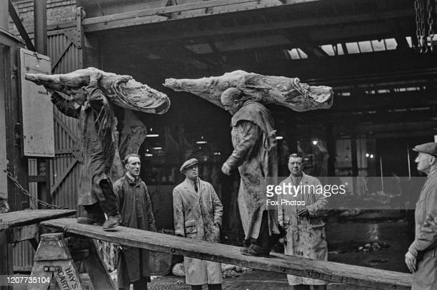 Meat being loaded onto the vans for distribution at the Caledonian Market, the Ministry of Food's 34-acre butcher's shop for London, supplying...