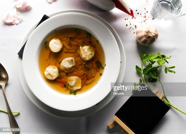 Meat broth with parsley in bowl