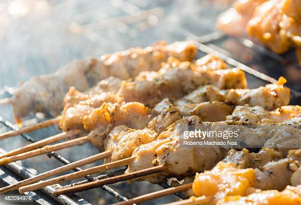 Meat cooking at the Taste of Little Italy Festival Chicken and pork souvlaki sit on a grill