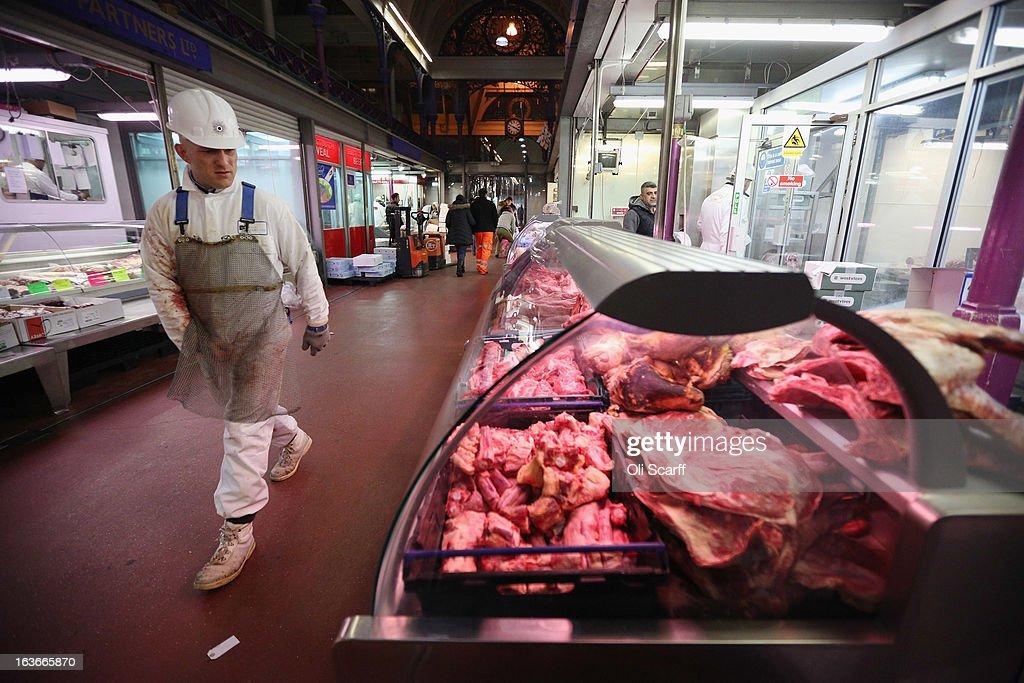Meat is displayed for sale on a butcher's stall in Smithfield Market on March 14, 2013 in London, England. Smithfield Market, which is officially named the 'London Central Markets', has been the site of a livestock market since the Twelfth Century. Located in the City of London, the market's Victorian buildings were designed by Sir Horace Jones, the City Architect, and were completed in the 1860s. Developers have recently proposed a 160 million GBP refurbishment of the derelict western end of Smithfield Market into an artisan food centre known as 'Smithfield Quarter'.