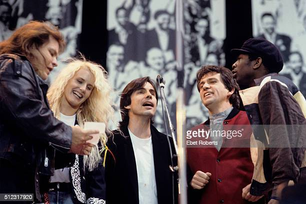 Meat Loaf Daryl Hannah Jackson Browne Peter Gabriel and Youssou N'Dour performing at Wembley Stadium in London England for the Nelson Mandela 70th...
