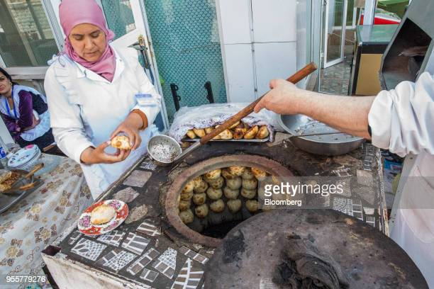 Meat pastries knows as 'Samsa' are cooked in an oven in Dushanbe Tajikistan on Sunday April 22 2018 Flung into independence after the Soviet Union...