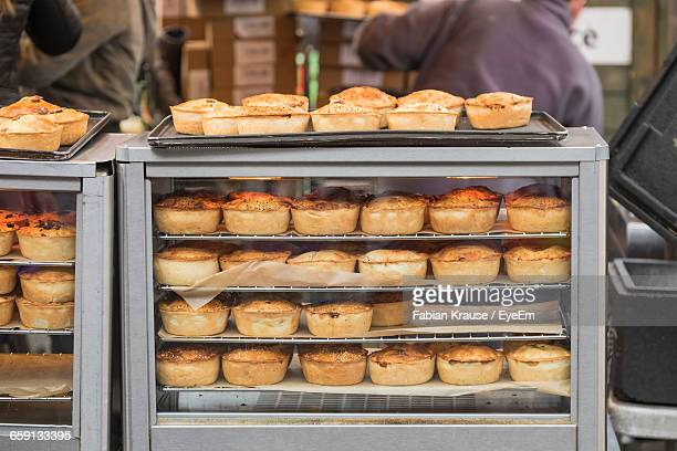Meat Pie Arranged In Display Cabinet At Shop