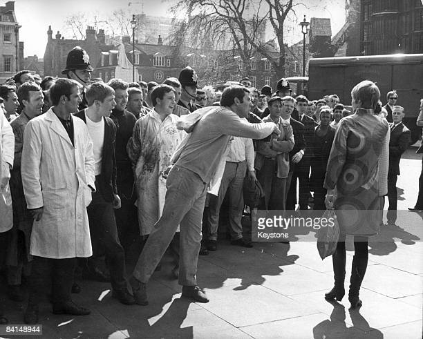 Meat porters from Smithfield Market become embroiled in an argument with Sharon Genasci secretary to two Labour MPs outside the House of Commons 24th...