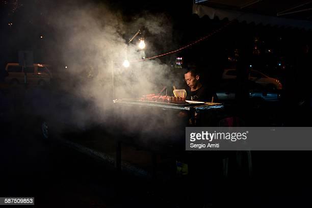 Meat seller in the Brunei night market
