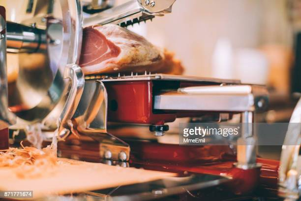 meat slicer with prosciutto - prosciutto stock photos and pictures