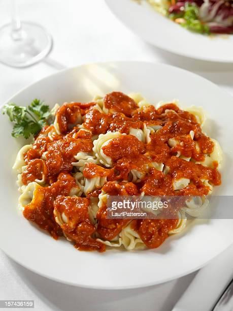 meat tortellini with marinara sauce - marinara stock photos and pictures