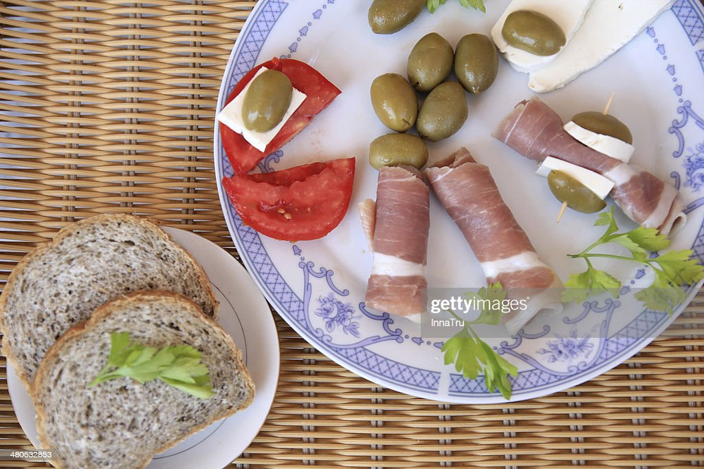 meat with olives : Stock Photo