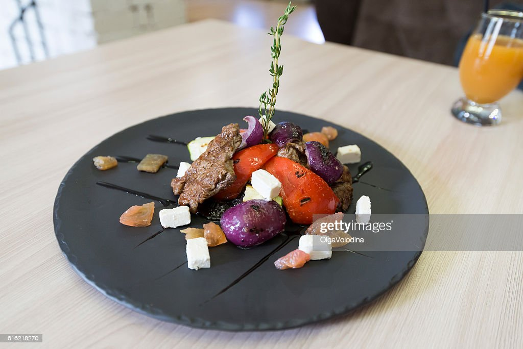 Meat with vegetables and cheese in restaurant : Foto stock