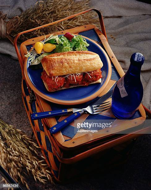meatball sandwich on picnic basket - grinder sandwich stock pictures, royalty-free photos & images