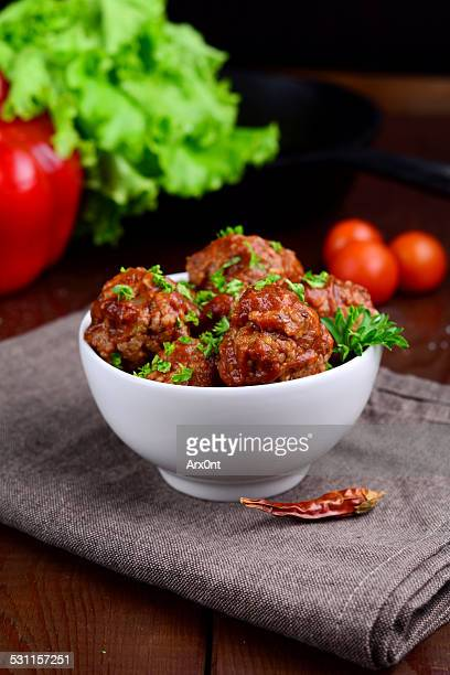 Meatballs in bowl with tomato sauce